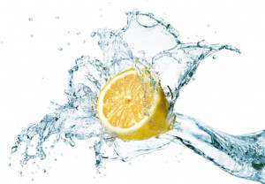 lemon is dropped into water splash